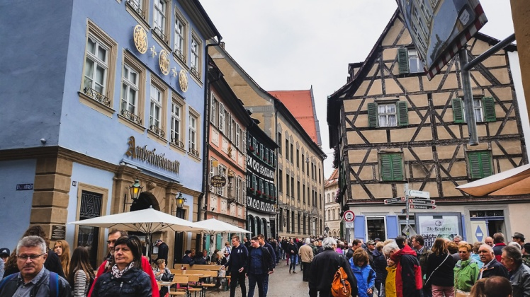 Tourists visiting the busy Sand Street of Bamberg